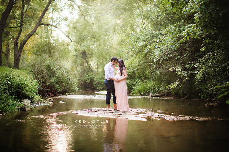 Maternity photography couple standing in a creek water - romantic